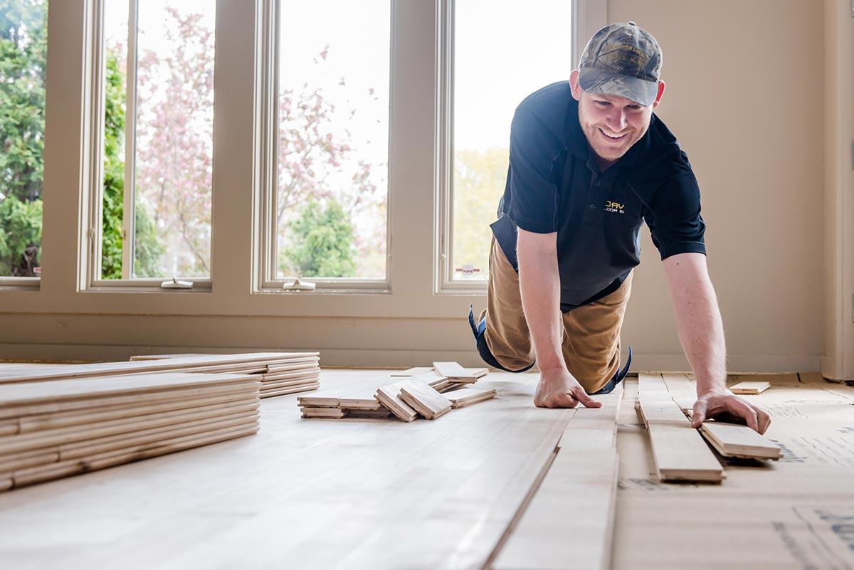 Man installing hard wood flooring
