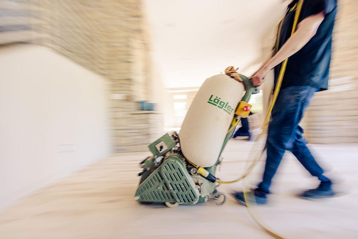 Man using a floor sander