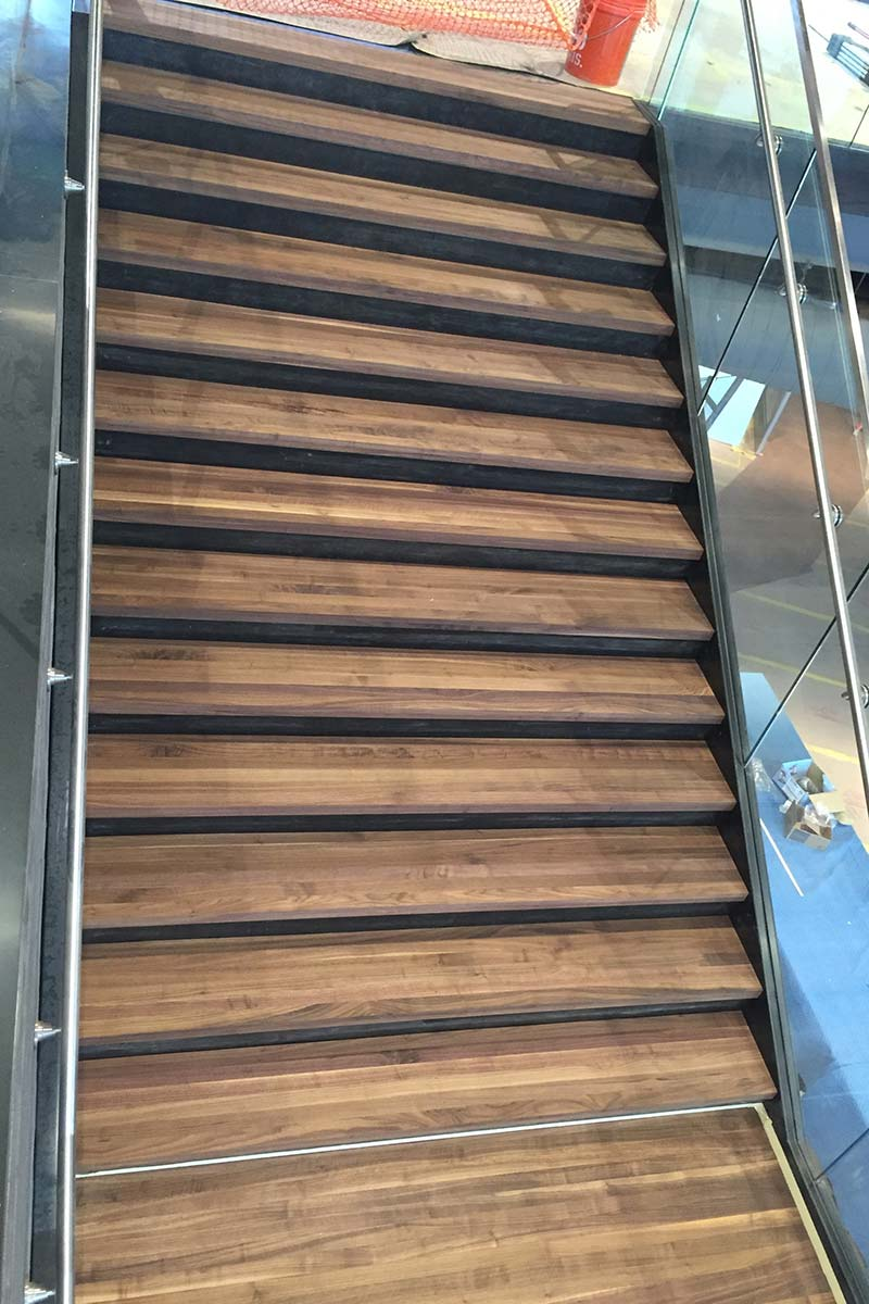 Anytime Fitness staircase with hardwood flooring MN