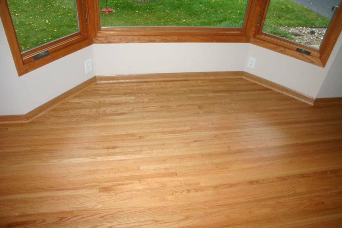 After restoration of hardwood flooring in bay window