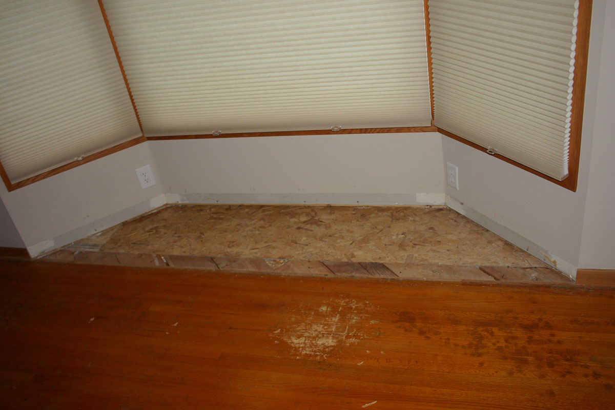 Before photo of flooring in bay window