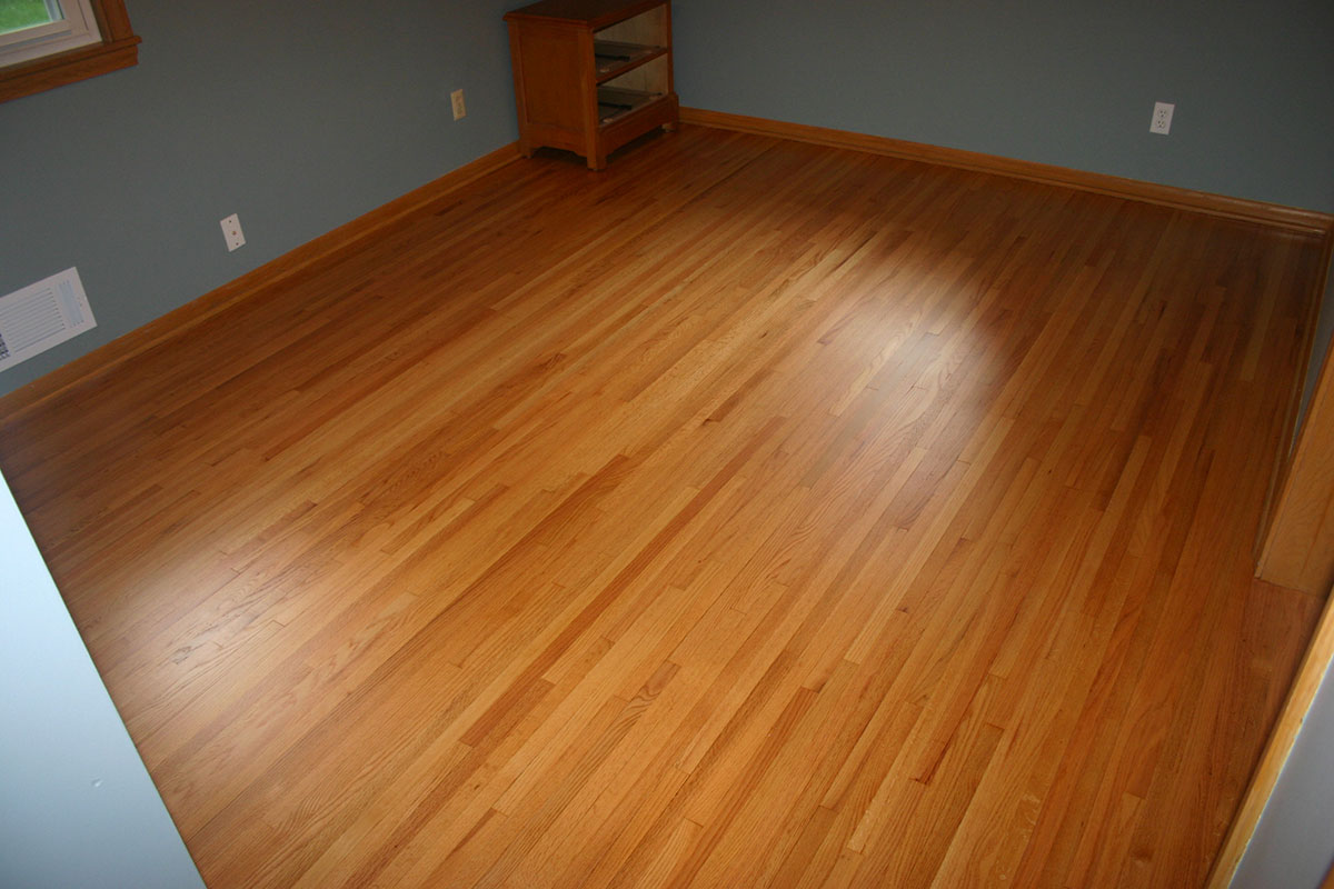 After photo of hardwood flooring in bedroom