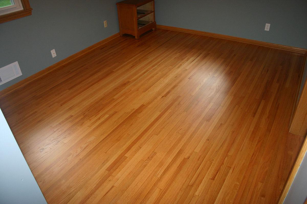 After photo of hardwood flooring restoration in bedroom