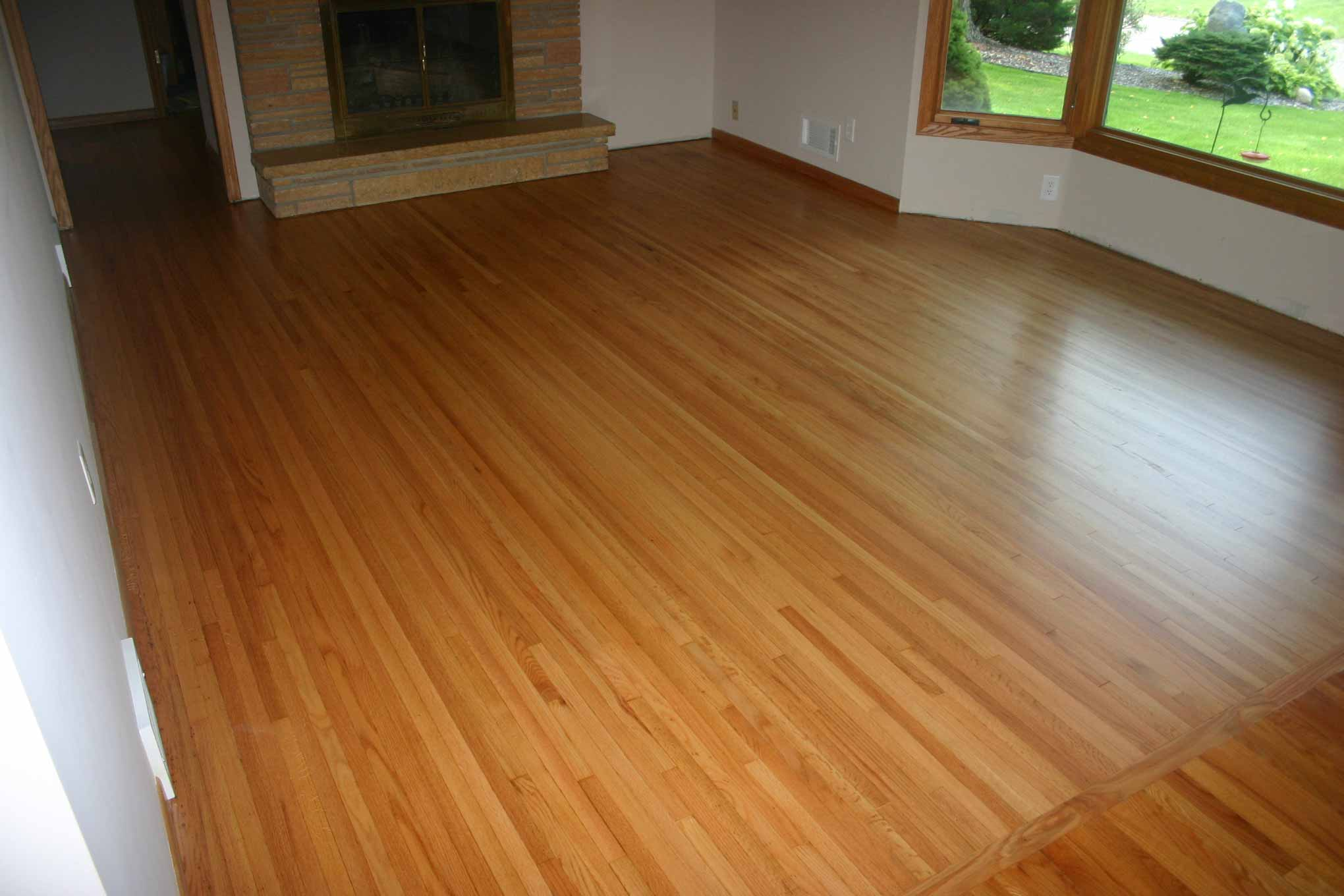 After photo of hardwood flooring in living room