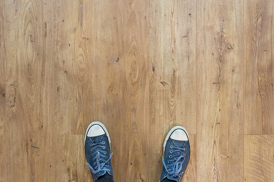sneakers on wood flooring