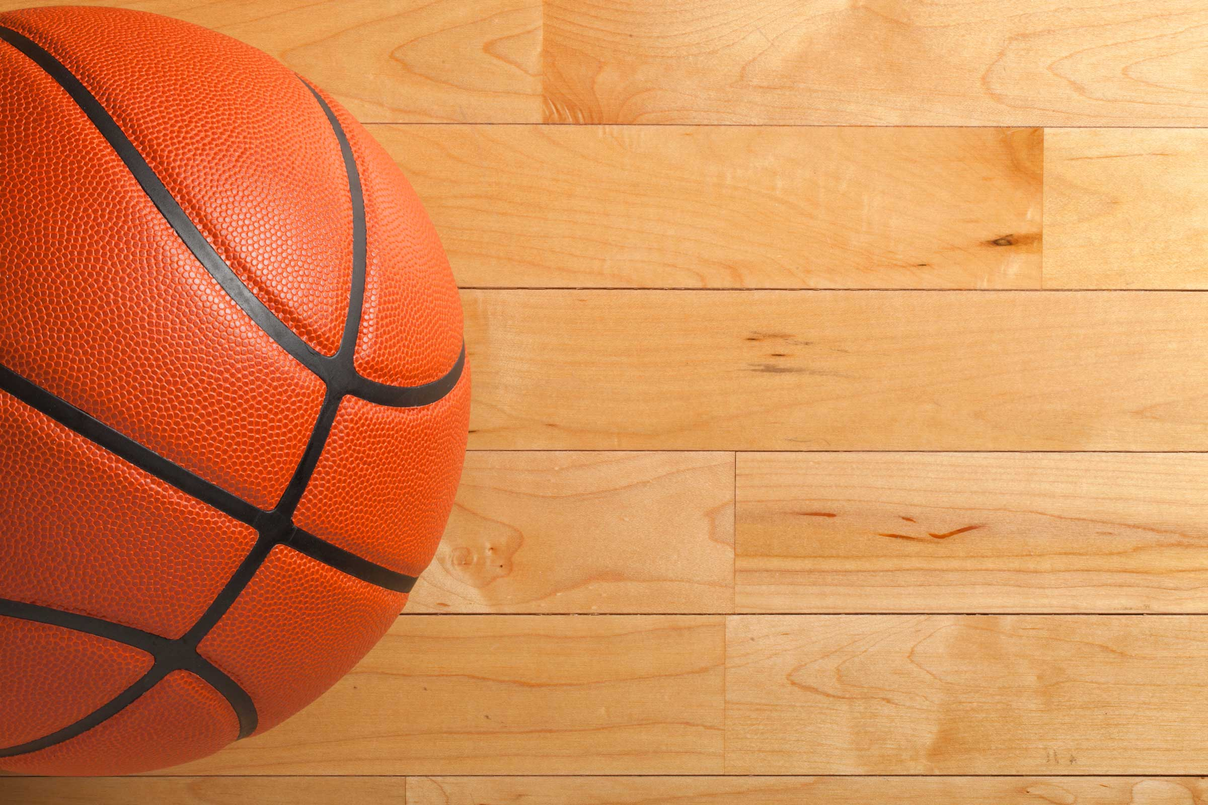 Basketball On A Maple Hardwood Court Floor