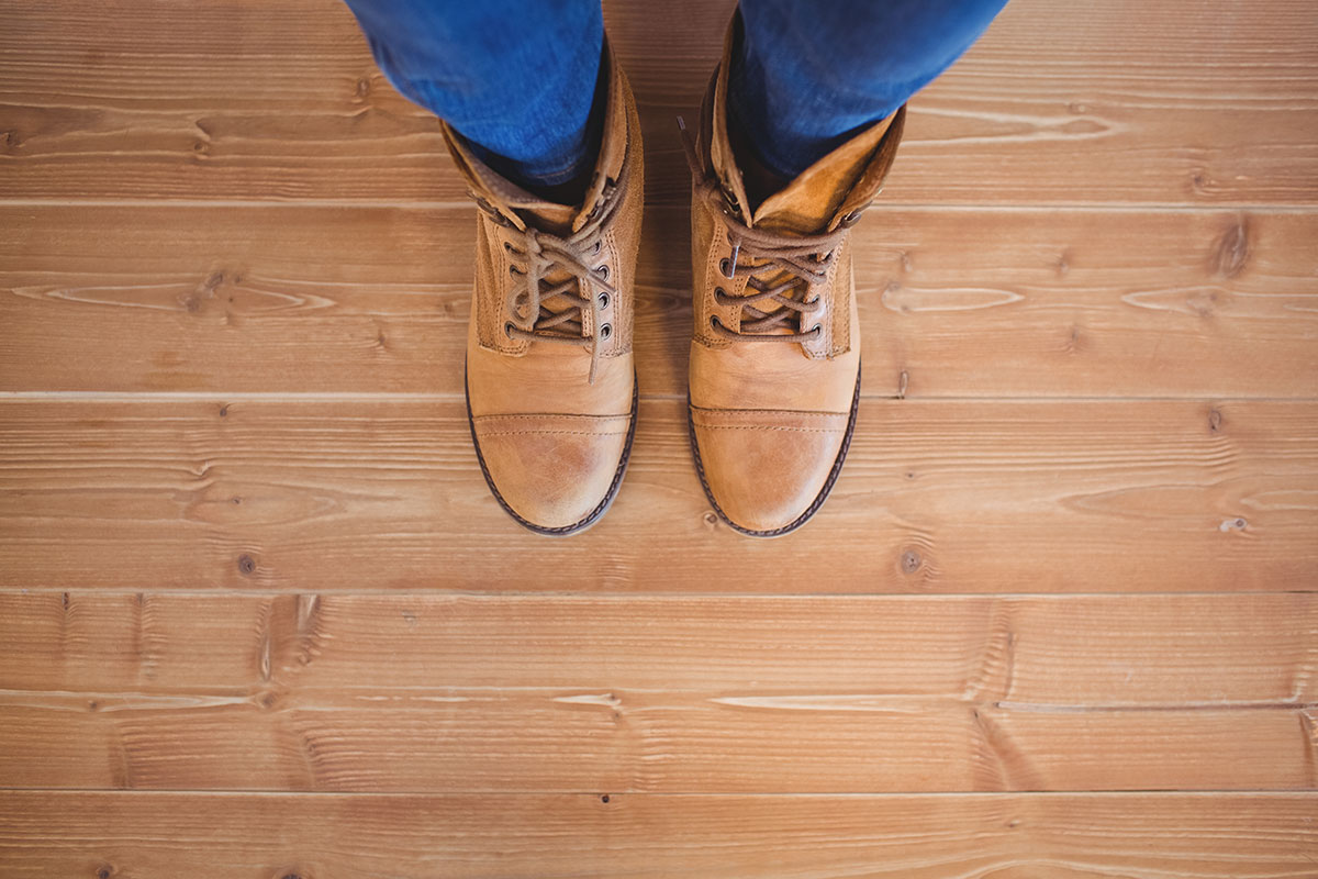 Woman Wearing Boots On Wood Floor