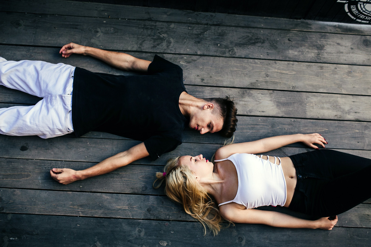 Couple Lying Together On The Hardwood Floor P6vefka